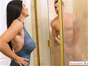 huge-boobed Romi Rain drives trouser snake into her fabulous vulva
