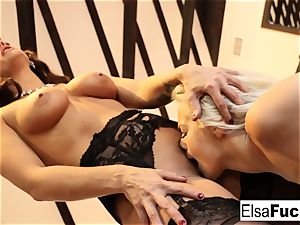 Elsa receives a tough lesson from her buxom lecturer Holly