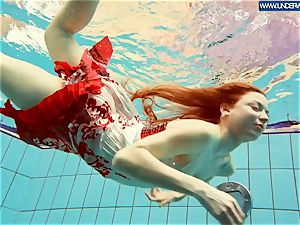 warm grind red-haired swimming in the pool