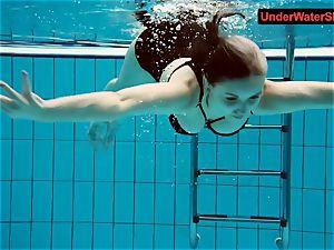 tattooed baby swirls underwater